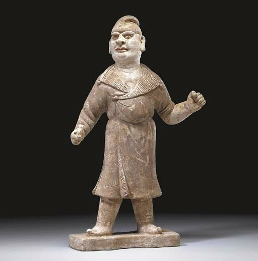 An unusual painted grey pottery figure of a foreign groom, Tang dynasty (618-907)