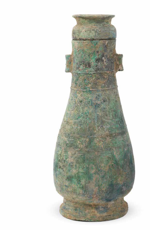 A rare archaic bronze 'phoenix' ritual wine vessel and cover, hu, Zhou Dynasty