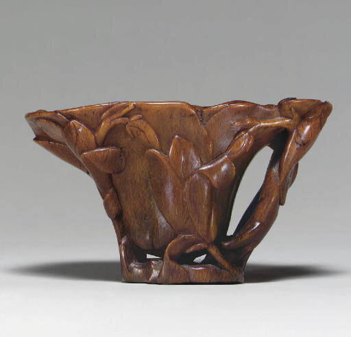 A rhinoceros horn magnolia-form libation cup, 17th century