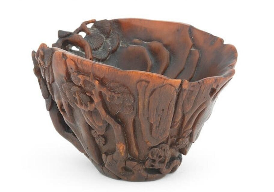 A rare rhinoceros horn 'pine and cliff' libation cup, 17th-18th century