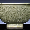 A carved Yaozhou celadon-glazed 'Peony' bowl, Northern Song dynasty (960-1127)