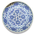 A large blue and white 'peony' charger, ming dynasty, 15th century
