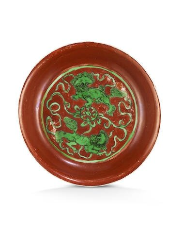 An iron-red and green enamelled 'Buddhist lions' dish, Jiajing six-character mark and of the period