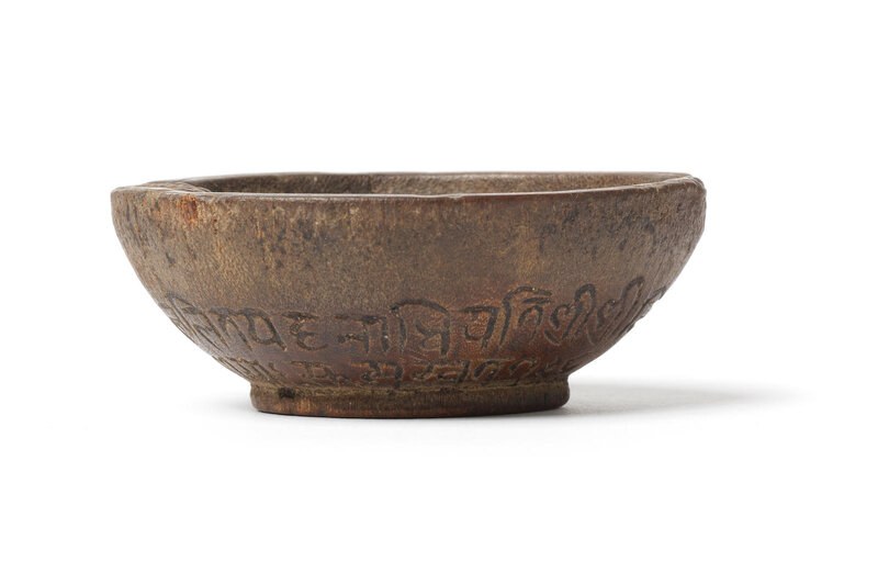 A rare small rhinoceros horn documentary 'vishnu' bowl, Nepal, dated by inscription to 1678 and of the period