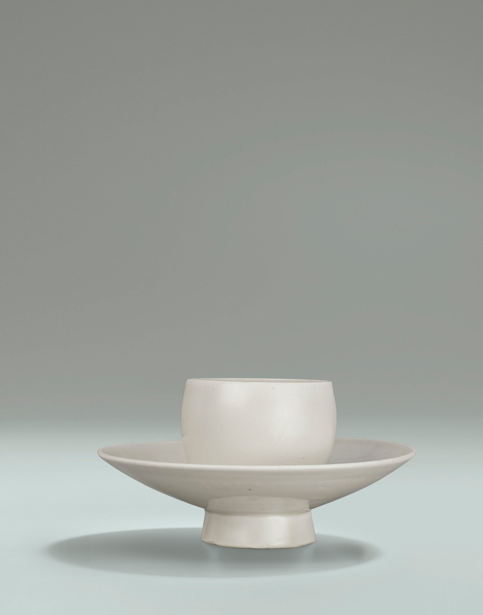 A Ding integral cup and cup stand , Northern Song Dynasty (960-1127)