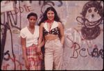 two-latino-girls-pose-in-front-of-graffiti-in-lynch-park-brooklyn