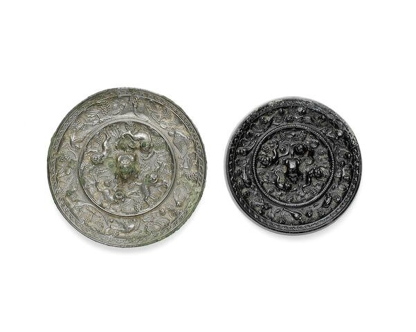 Two bronze 'lion and grapevine' mirrors, Tang Dynasty
