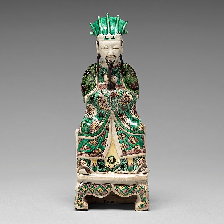 A biscuit figure of a court official, Qing dynasty, Kangxi (1662-1722)