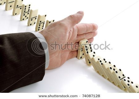 stock-photo-concept-for-solution-to-a-problem-by-stopping-the-domino-effect-74087128