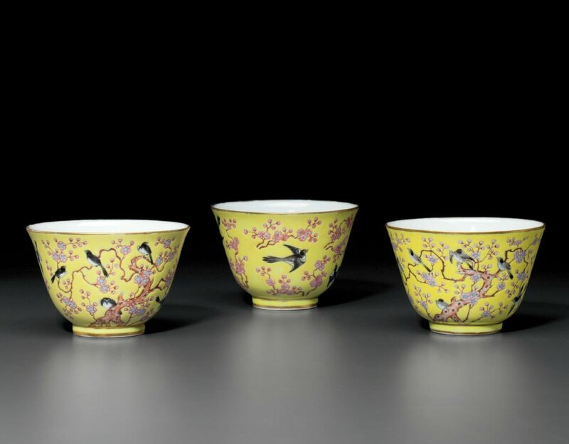 Three famille rose yellow-ground 'Magpie and Prunus' cups, Tongzhi four-character marks in iron red and of the period (1862-1874)