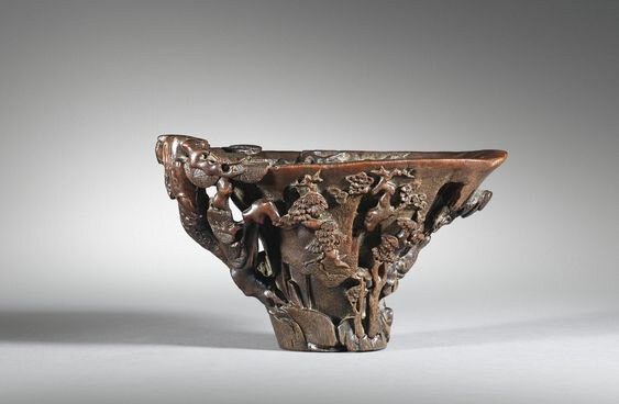 A carved rhinoceros horn 'landscape' libation cup, China, Qing Dynasty, 17th-18th century
