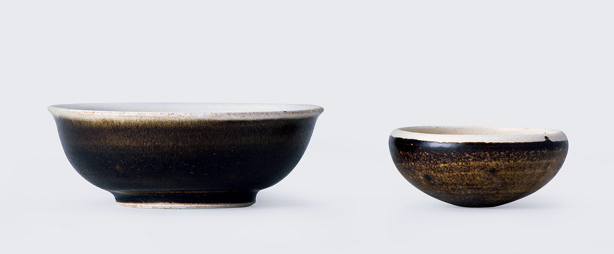 Two white-brown-glazed bowls, Tang dynasty (618-907)