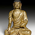 A gilt stucco figure of a buddha, china, ming dynasty, ca. 16th century