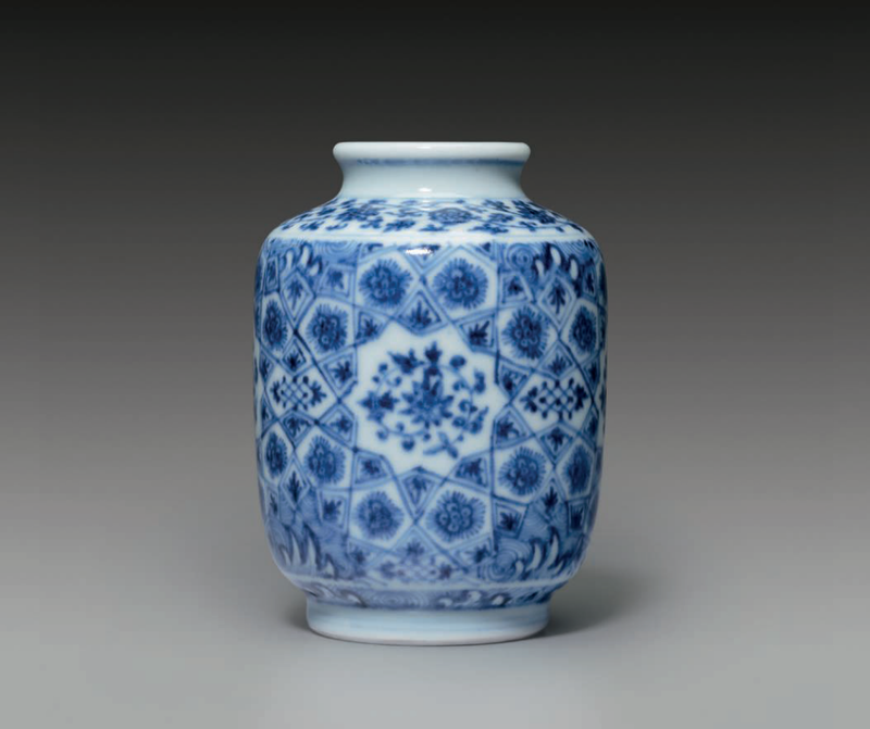 A small Ming-style blue and white cylindrical jar, Yongzheng six-character mark in underglaze blue within a double circle and of the period (1723-1735)
