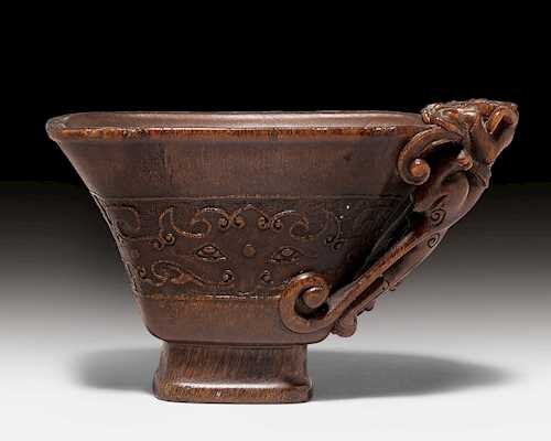 A small rhinoceros horn libation cup with archaistic decoration, China, 17th century
