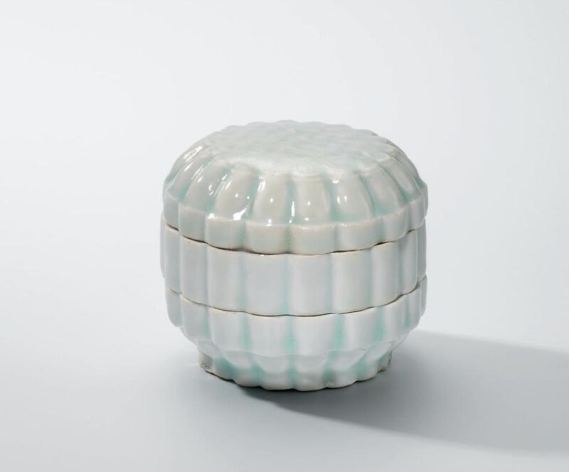 A Qingbai three-tiered chrysanthemum-shaped box and cover, Song dynasty (960-1279)