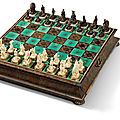 A silver-inlaid, tortoiseshell-veneered, carved ivory and ebonised wood chess set, augsburg, circa 1705-1709