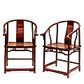 A pair of huanghuali horseshoe-back armchairs, 18th century