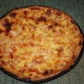 2009 04 17 Une tarte au pomme en dès mélanger a de la crème pâtissière aux amandes effilées