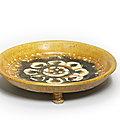 A sancai-glazed tripod dish, Tang Dynasty (618-907)