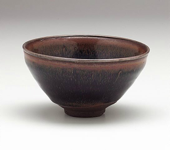 Jian ware tea bowl, China, Fujian province, Song dynasty (960-1279), stoneware, tenmoku glaze, silver rim, 6.9 x 12.4 cm. Purchased 1965. EC4.1965. Art Gallery of New South Wales, Sydney (C) Art Gallery of New South Wales, Sydney