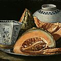 Cristoforo munari (reggio emillia 1667 – 1720 pisa), a still-life with melon, an octagonal blue and white cup on a silver charge