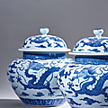 A rare pair of blue and white 'dragon' jars and covers, qing dynasty, 18th century