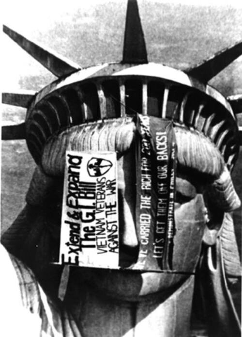 VVAW protesters hang banners from the Statue of Liberty's crown in December, 1971