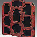 A rare carved red lacquer hanging display cabinet, qianlong period (1736-1795)