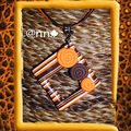 Collier FIMO carré évidé rayé orange chocolat, spirales orange (N)