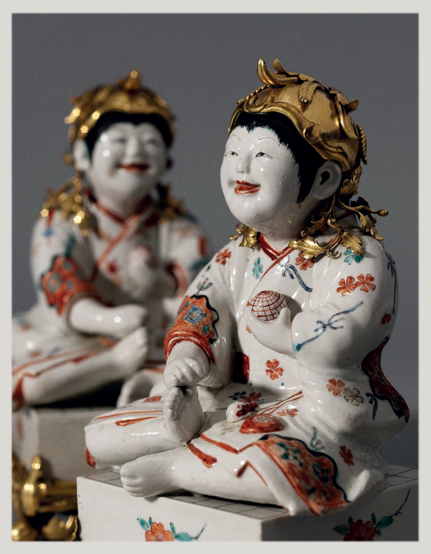 A Pair of Kakiemon Models of Karako (Chinese Boys) Seated on Go Boards with French Gilt Bronze Mounts 1