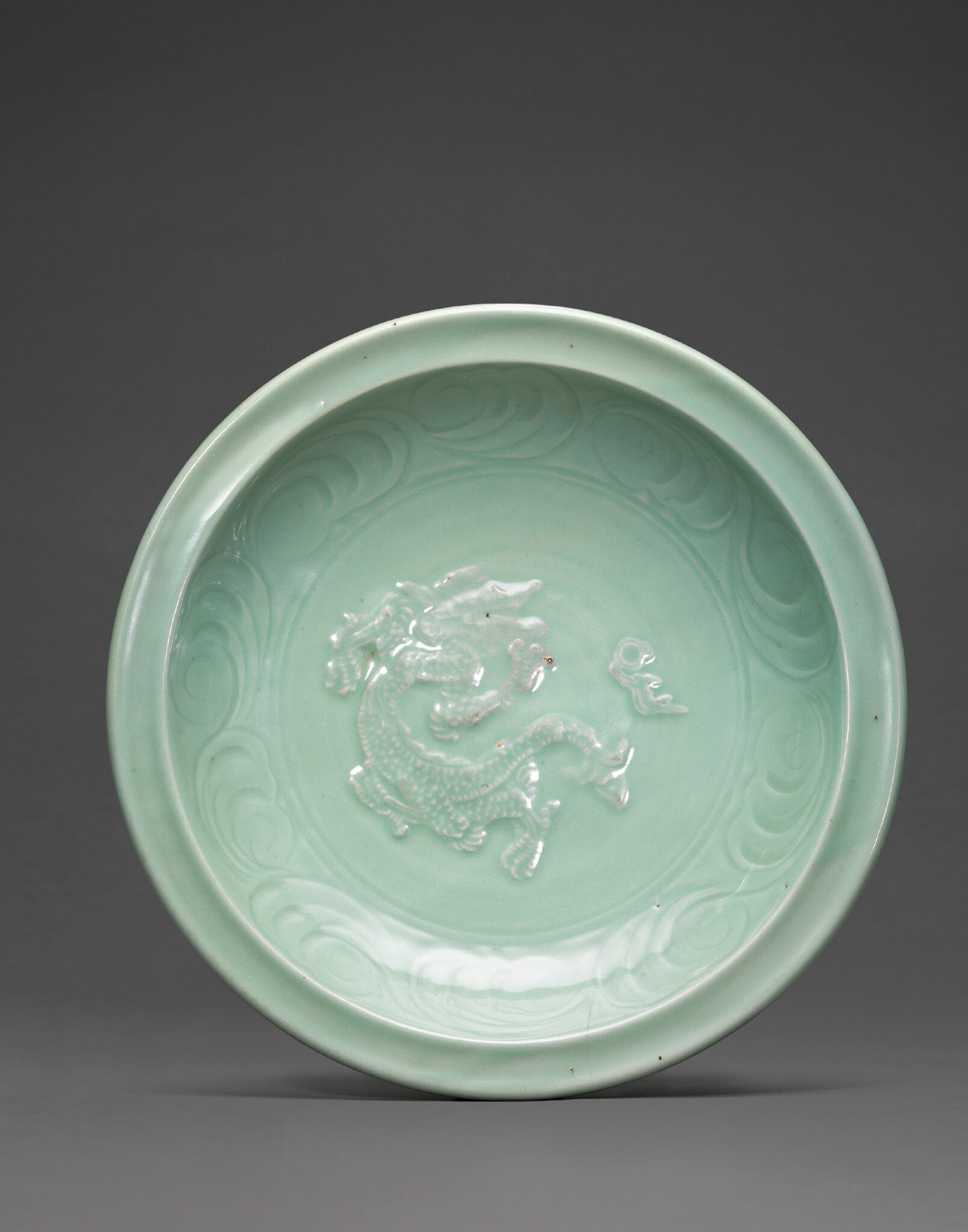 A rare Longquan celadon 'Dragon' charger, Ming dynasty, 15th century