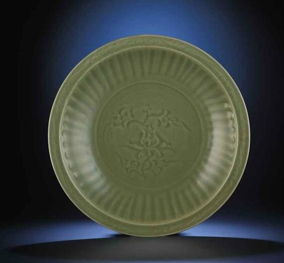 A large Longquan celadon carved 'lotus' charger, Ming dynasty, 15th century