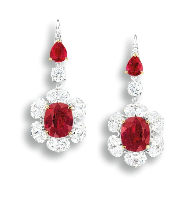 A Very Fine Pair of 3.50 and 3.24-carat unheated Burmese Mogok pigeon's blood red Ruby and Diamond Pendent Earrings