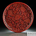 A very rare, large circular, carved cinnabar lacquer (tihong) dish, yongle incised six character mark and of the period