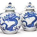A fine and rare pair of blue and white 'dragon' jarlets and covers, kangxi marks and period(1662-1722)