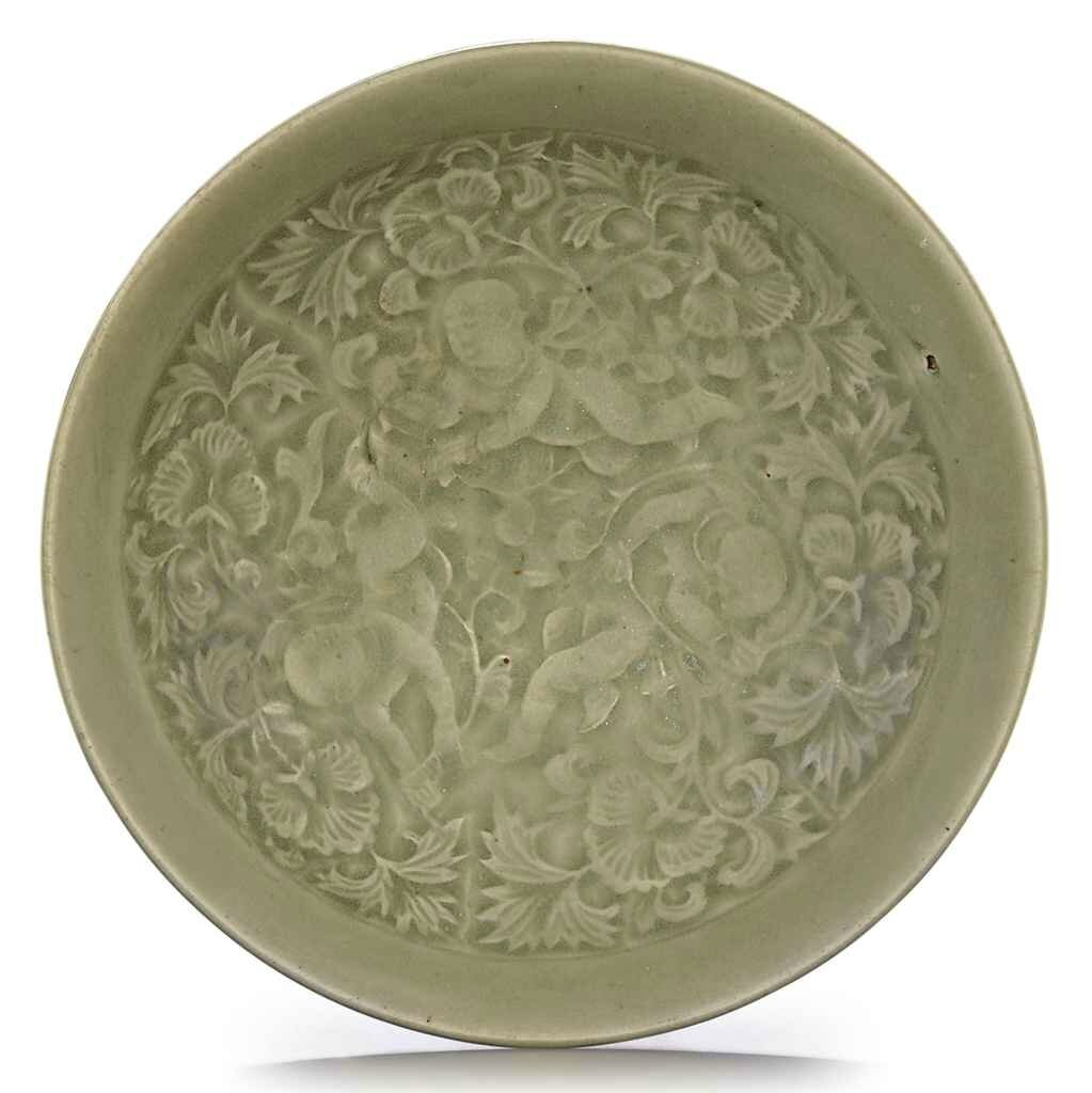 A Yaozhou celadon molded shallow dish, Northern Song-Jin dynasty, 11th-12th century
