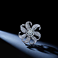 An art moderne diamond clip, paul flato, with accompanying fitted bangle, van cleef & arpels, circa 1935