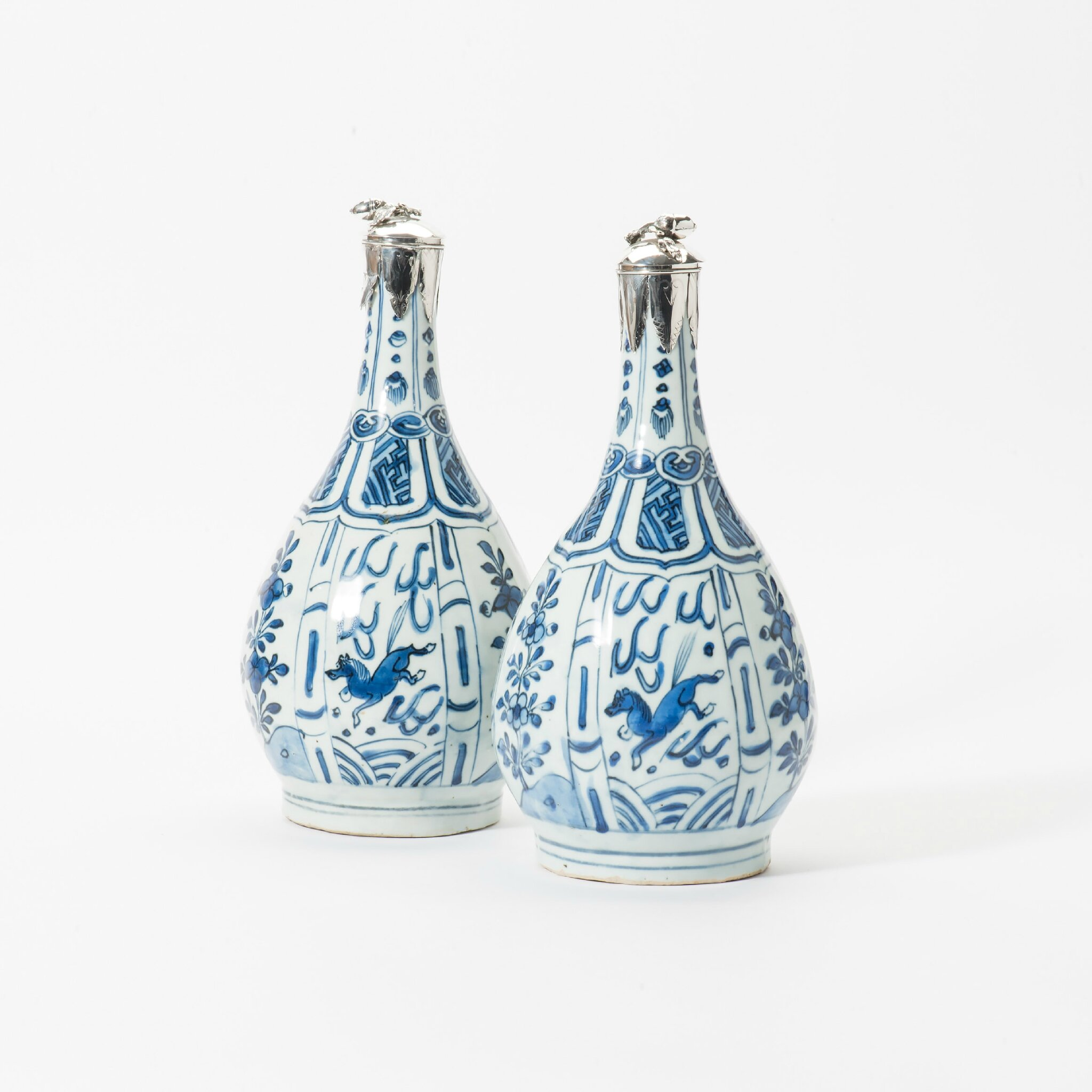 A pair of pear-shaped Kraak porcelain bottles, Wanli period (1573-1619)