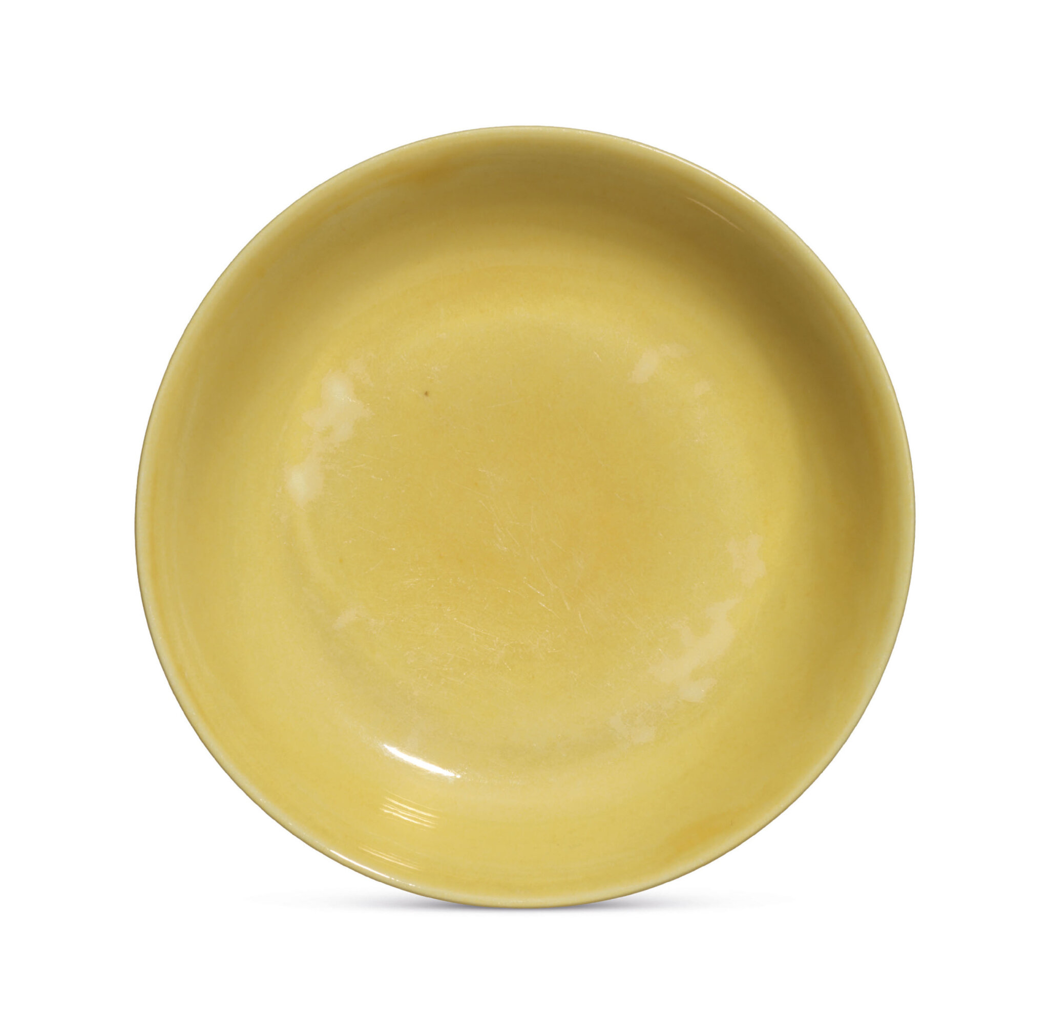 A yellow-enamelled dish, Zhengde six-character mark within a double circle and of the period (1506-1521)
