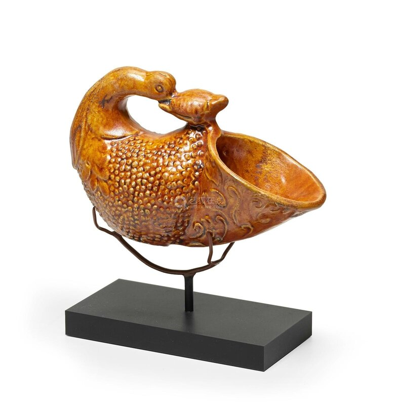 An amber-glazed pottery goose-head rhyton, Tang dynasty (618-907)