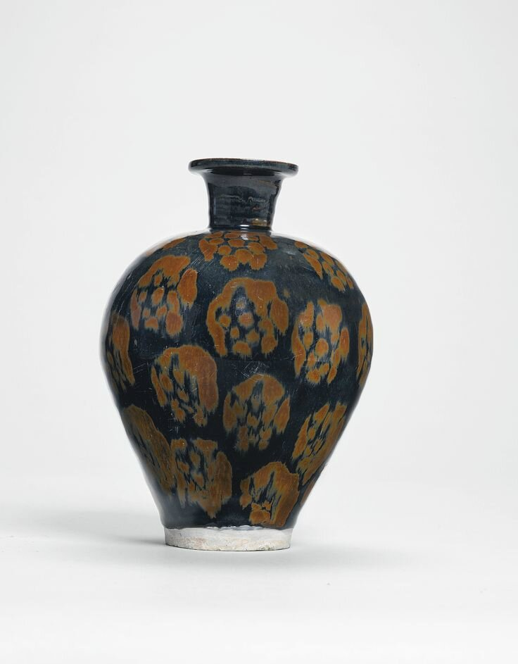 A black-glazed and russet jar, Song dynasty