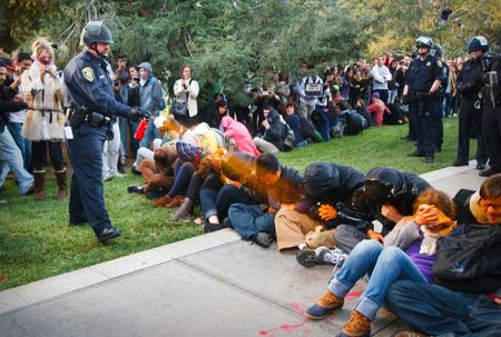 enhanced-buzz-wide-26539-1322960640-2 A University of California Davis police officer pepper-sprays students during their sit-in at an Occupy UCD demonstration in Davis, California