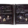 A pair of sandalwood, zitan 'scrolls' panels, 18th century