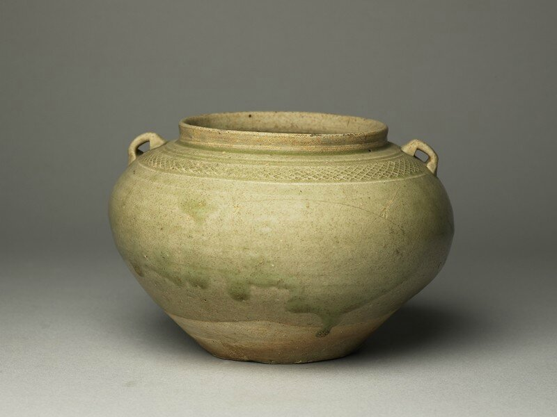 Greenware guan, or jar, with loop handles, Yue kiln-sites, l6th - 7th century AD