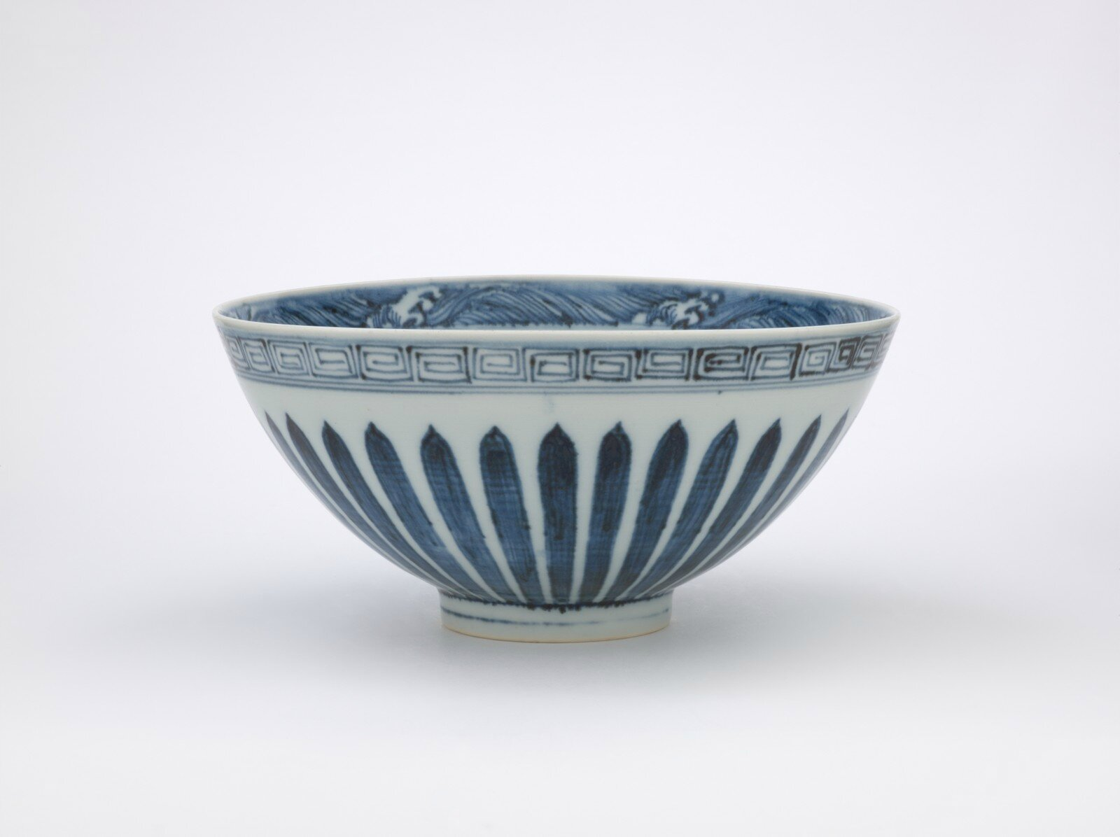 Bowl with loquat and floral designs, Ming dynasty, early 1400s, Yongle period, porcelain with underglaze blue, 4 x 8 1/4 (diam.) in. Gift of Mr. and Mrs. Eli Lilly. 60.107. Indianapolis Museum of Art © 2014 IMA