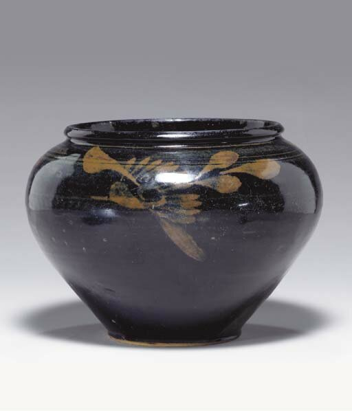 A russet-painted black-glazed jar, Jin dynasty (1115-1234)