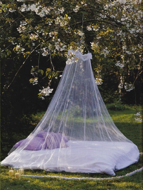 lilac-and-white-bed-outside-with-a-mosquito-net2