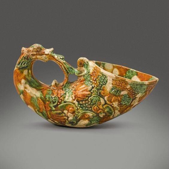 A rare sancai glazed pottery rhyton, Tang dynasty