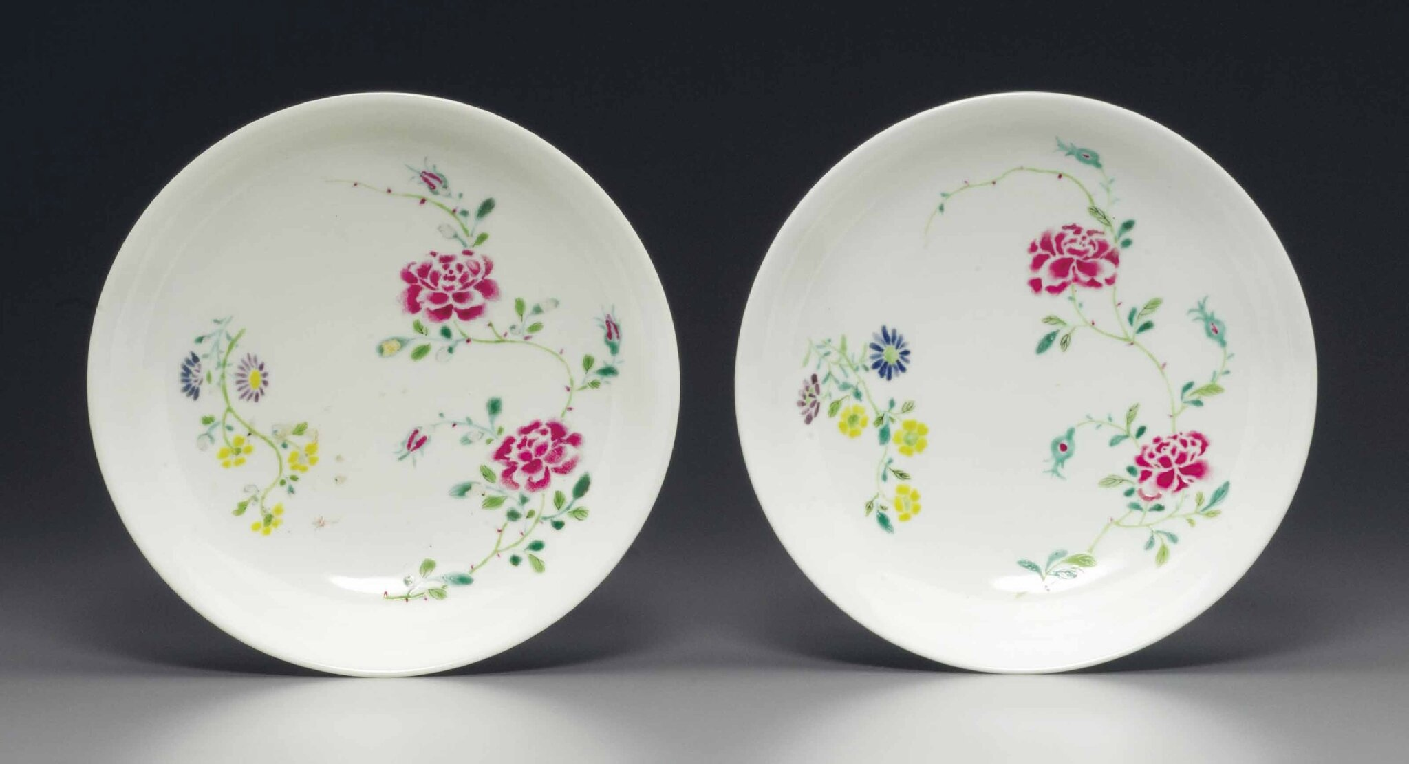 A pair of famille rose 'boneless' saucer dishes, Yongzheng six-character marks in underglazze blue within double circiles and of the period (1723-1735)